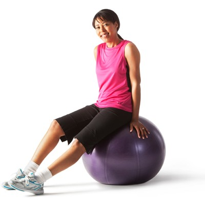 Woman sitting on aerobics ball