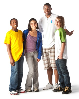 Young kids standing with YMCA staff member