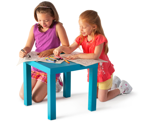 Young girls coloring on table